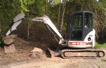 Bobcat Services for installing Lawn Irrigation Systems and Creative Ponds